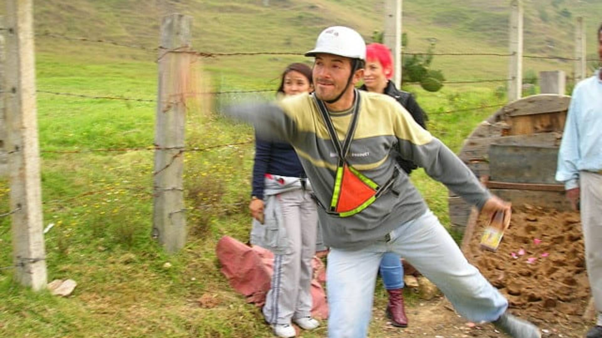 man playing the colombian sport of tejo