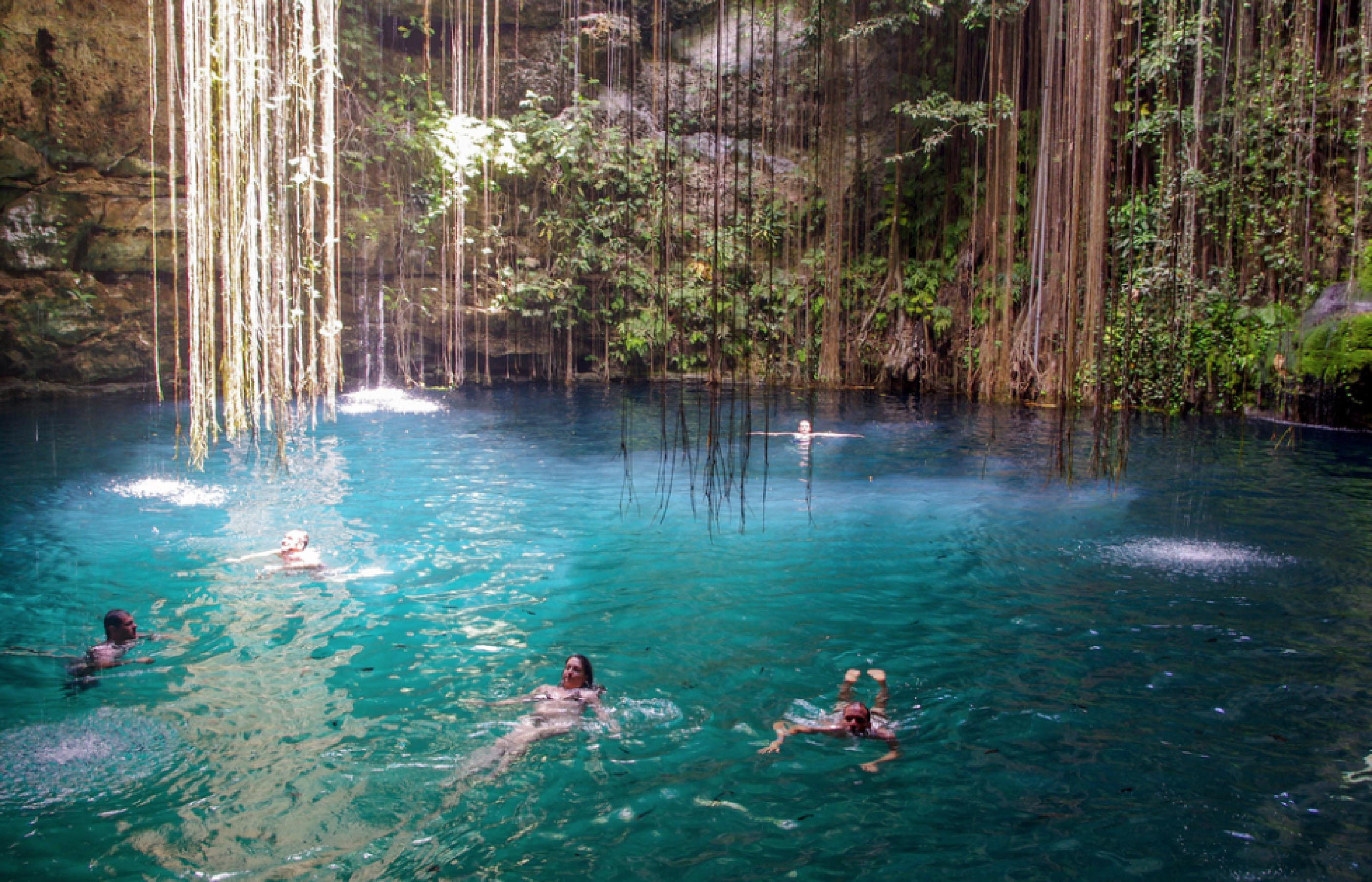 people bathing in yucatan