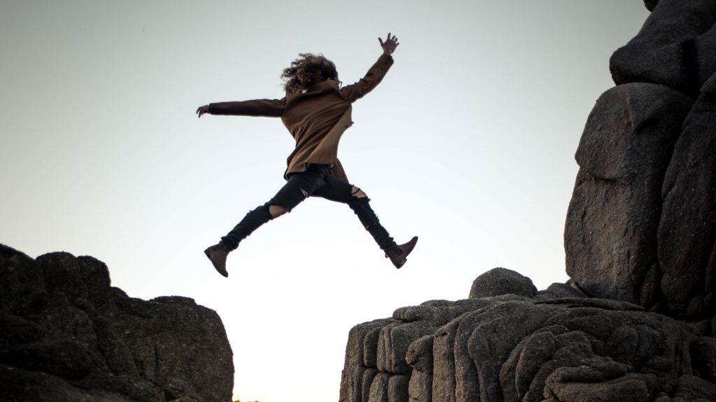 A woman making a leap of faith