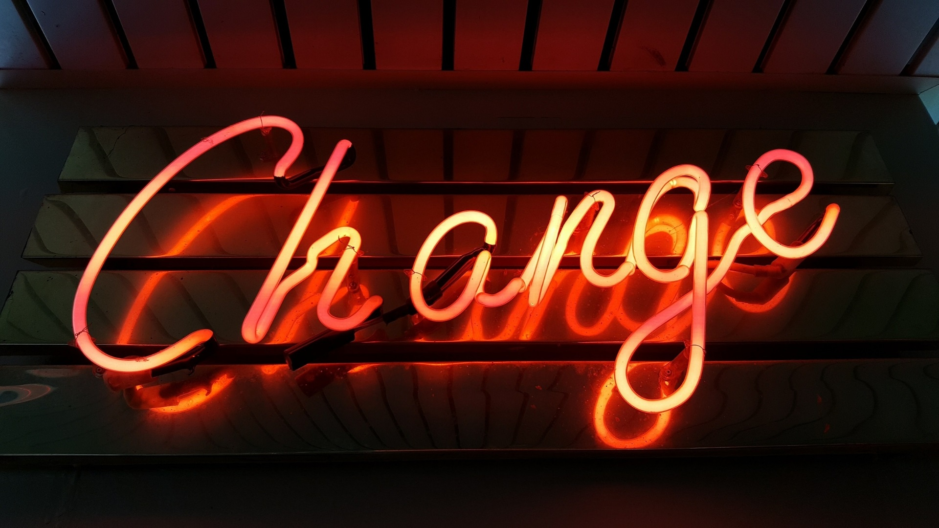 "A neon sign that reads ""change"""