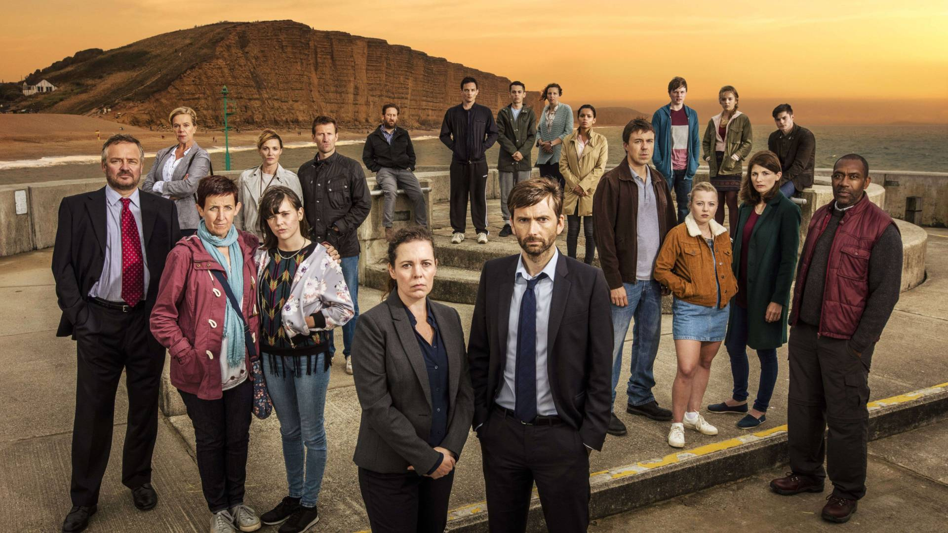 photo of teh cast of broadchurch on west bay beach dorest